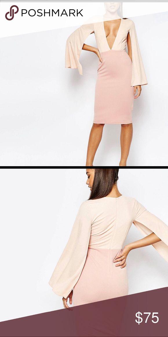 Cape Dress V Neck Cape Midi Dress. Crepe Fabric. Lined body. Plunge Neckline. Inner gripper tape. Zip back fastening. Close cut body conscious fit. Hand wash. 95% Polyester. 5% Elastane. Dresses Midi