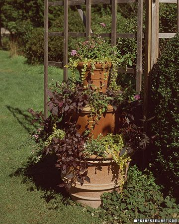 How to use tiered planters.  This would be perfect for our tiny apartment porch.  Planning to do this in the spring!
