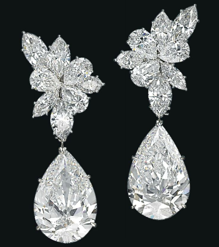 Harry Winston - A Pair of Diamond Ear Pendants - Each top designed as a cluster of marquise and pear-shaped diamonds, suspending a detachable pear-shaped diamond, weighing approximately 19.57 and 19.09 carats, mounted in platinum, 5.5 cm. With maker's mark for Jacques Timey and signed Winston for Harry Winston.