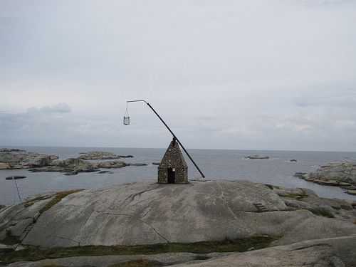 """Norway - End of the world. In Norwegian you say """"verdensende""""  It is a light house that was used by the vikings hundreds of years ago.  Hot coals were put in the basket and they glowed to warn ships of the rocks.Lights House, Years Ago, Lighthouses, Vikings Hundreds, Hot Coal, Warning Ships, The Rock, Baskets, Light Houses"""