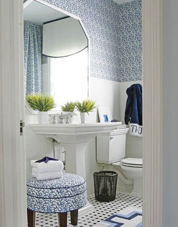 Make-over Bathroom After:   Keller's fond of blue (as you can see), and he often uses several shades of it in one room to bring it all together. And don't be afraid to mix it up! The rug on the floor has a different pattern than the wallpaper and stool, but it still feels organic to the room due to its colors.