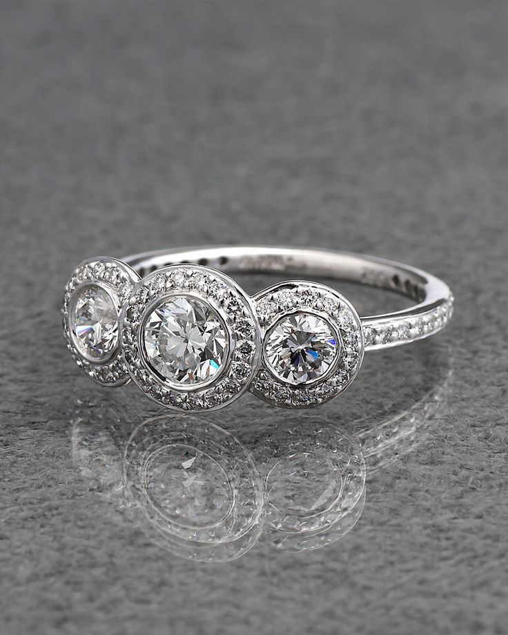 Ritani 18K White Gold Three Stone Halo Diamond Ring - explore the art deco collection http://www.ritani.com/engagement-rings/style/art-deco-engagement-rings