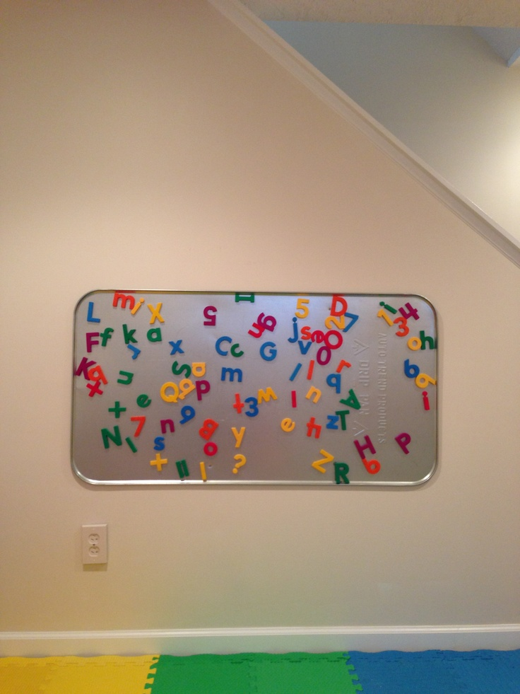Magnetic board for finished basement playroom. I screwed this oil drip pan from Walmart directly into the wall studs.  From:   http://nicandkate09.blogspot.com/2011/08/alphabet-board.html
