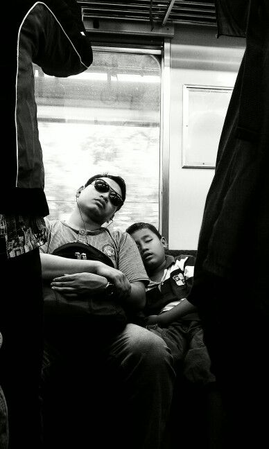 Sleepless commuter on the train #jakarta