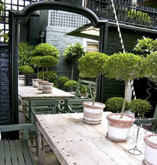 GLAMMED up PATIO.  mirrors, chandeliers, Arts & Vases ... yes!