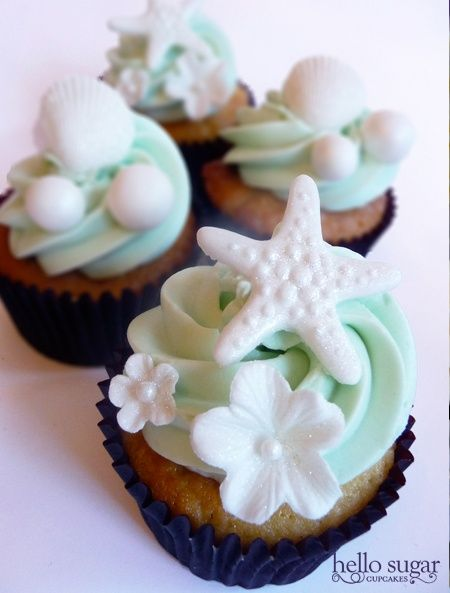 Beach themed wedding cupcakes. I don't like the flowers or weird balls that I think are supposed to be pearls.. but the starfish and sea shells are pretty.