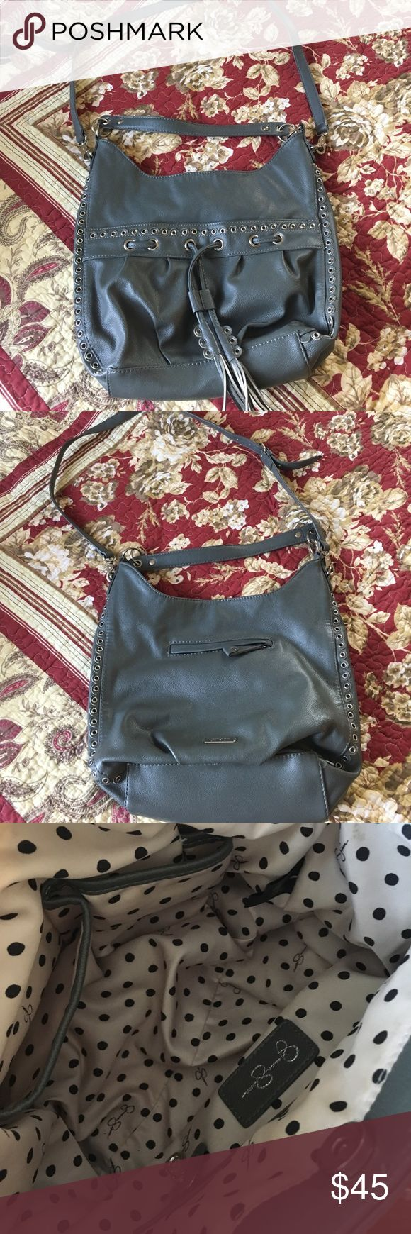 Jessica Simpson Handbag Gray Jessica Simpson handbag. Gray hand bag with shorter, over the shoulder strap and longer, removable cross body strap. This bag has 2 outside pockets, and one inside pocket. Handbag also features 2 interior slip pockets and one zipper pocket. Outside has scalloped edges with rivets, which makes it super cute! Excellent condition!! No stains or signs of wear!! Bundle and save 10%. Comment if you have questions or make an offer!! Jessica Simpson Bags Crossbody Bags