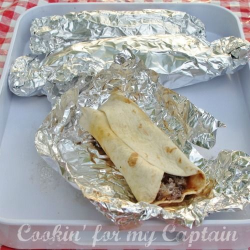 Tin Foil Dinners for the camp. Site has lots of great ideas...including: foil wrapped breakfast burritos you just heat up on the fire in the morning, and pork chop packets with pineapple, onion, and peppers.  Totally making some of these soon!!