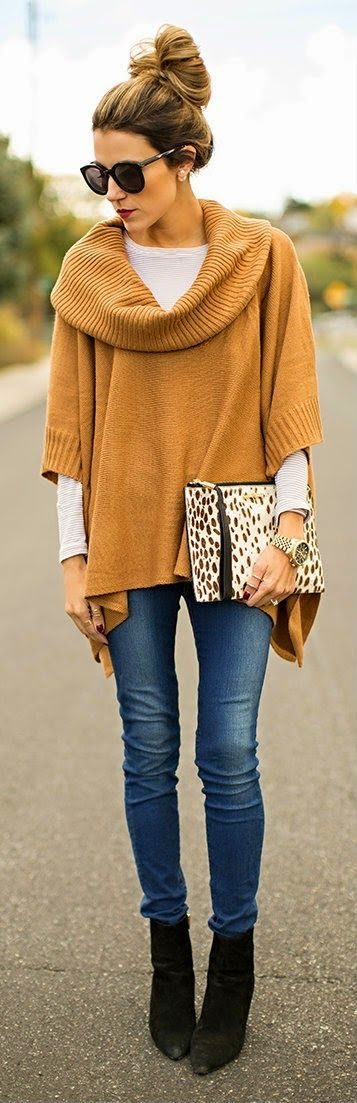 Amazing Mustard Color Sweater Poncho with Blue Jeans, Black Suede Boots, Leopard Clutch Bag and Accessories