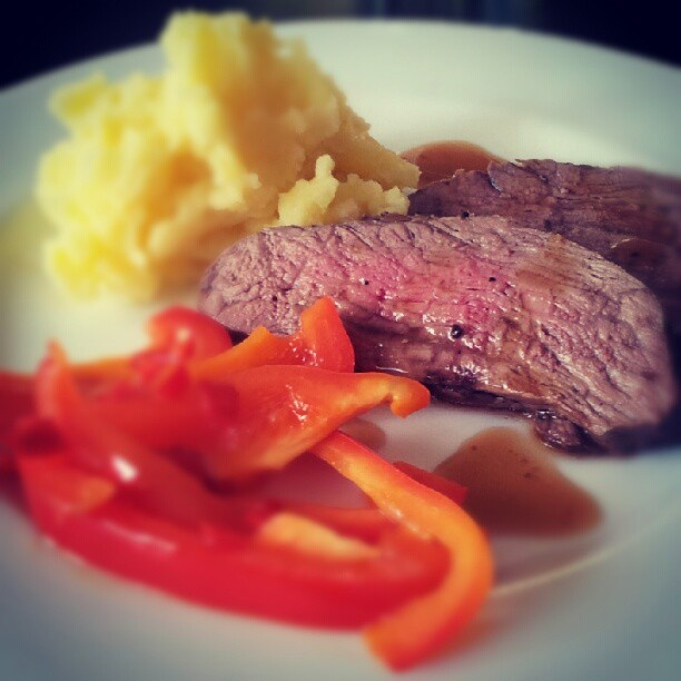 Lamb steak with mashed potatoes and fried paprika