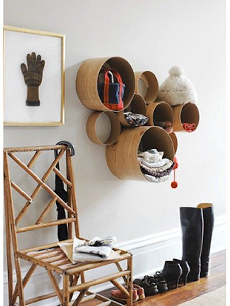 Cardboard tubes and contact paper are used to create this sculptural shelf unit - but I could see them made with salvage flooring as well. Source: Country Living Magazine