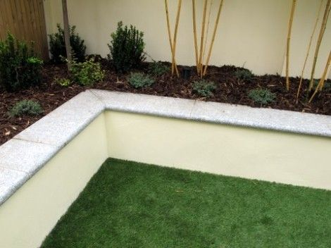 Raised bed with bullnosed granite wall capping our for Raised garden wall ideas