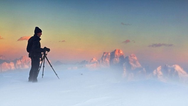 I'm on top of the world: Stunning extreme weather pictures appear to show photographer standing in the clouds