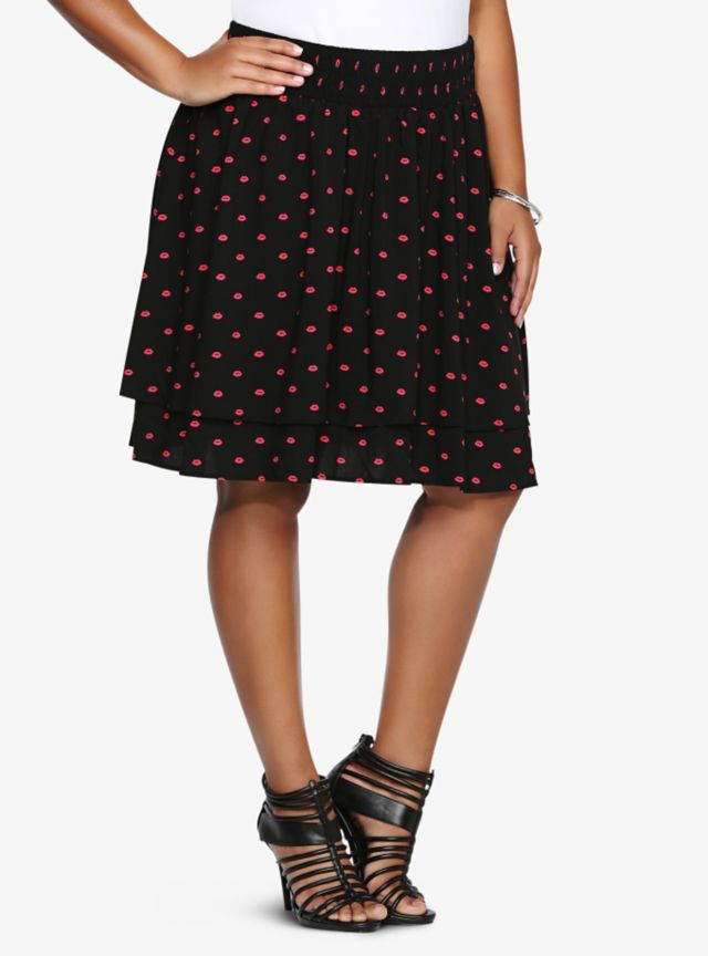 Pucker up! Loose lips may sink ships, but whatever, we'll take the risk: this skater style skirt is a must-have! Pretty pink puckered lips dot the black design, giving the skirt a retro feel. It has a smocked elastic waist, so staying comfortable won't be a problem.
