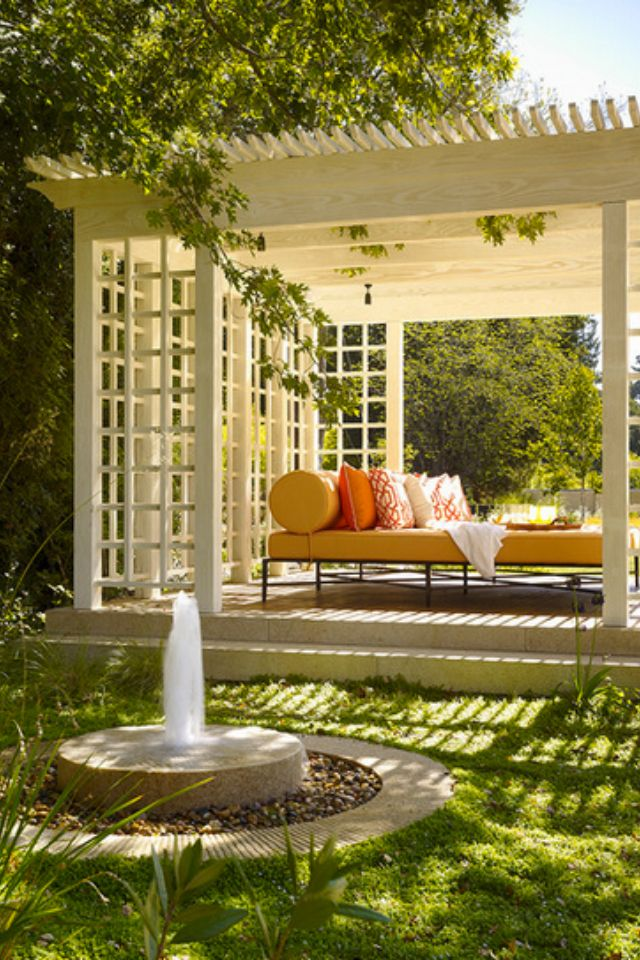 What a wonderful place to relax ..... a gorgeous pergola with the soothing sound of a water feature.