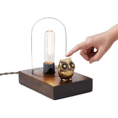 More than just an endearing ornament, the owl acts as the switch for the fixture; simply touch any part of it to toggle through three levels of brightness or turn the light off.