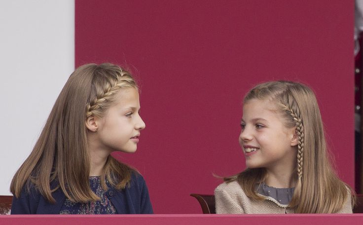 Princess Leonor and Infanta Sofía keep each other entertained during the National Day Military Parade. The Best Photos of the Spanish Royal Family in 2015