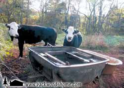 """Build Your Own Solar-Powered Water Pumping Station, by Jeffrey Yago. """"I recently designed a solar-powered pumping system for a local farmer wanting to pump water from a lake up to a watering trough for cattle in a distant fenced field."""""""