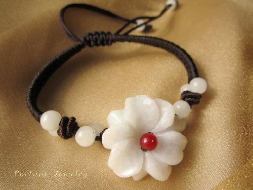 White Blossom Flower Carved Jade Bracelet (Brown String) by Fortune Jewelry & Healing Beauty, http://www.amazon.com/dp/B00BGNQOYG/ref=cm_sw_r_pi_dp_NM.hrb1B8H8HX
