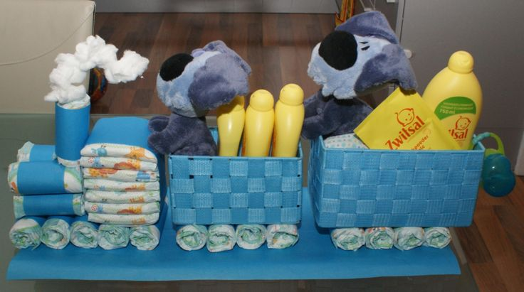 Baby shower train with towels, diapers and baby toys