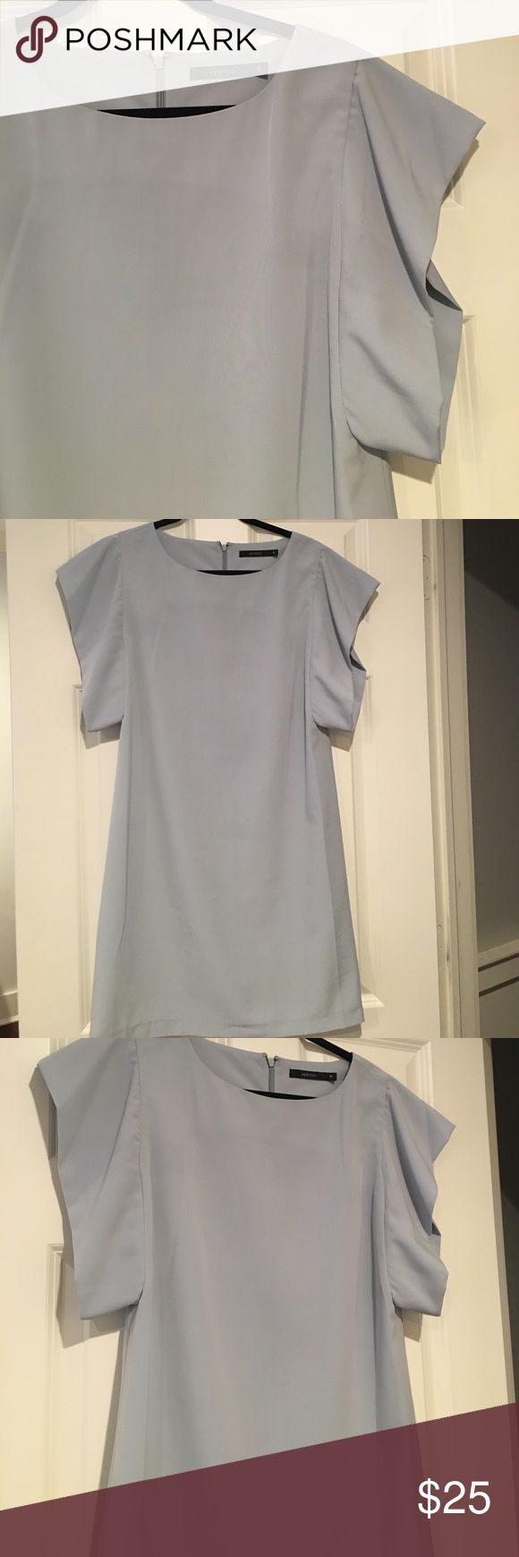 Vertigo pale blue dress Size medium. Perfect dress for spring and summer. A little bit of the stiching came up do as shown in the pic. But the zipper covers it. vertigo Dresses