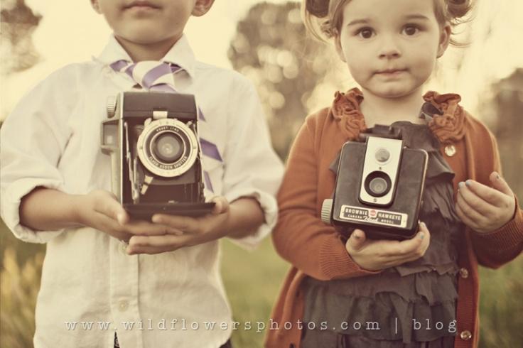 Kids holding vintage cameras, by wild flowers photo #children #kid #photo #photography #idea #ideas