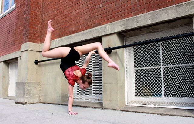 Contortion while holding railing, Inglewood.
