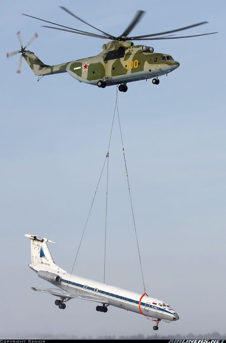 Russian Mil Mi-26 helicopter transporting a Tupolev Tu-134A-3 airliner.