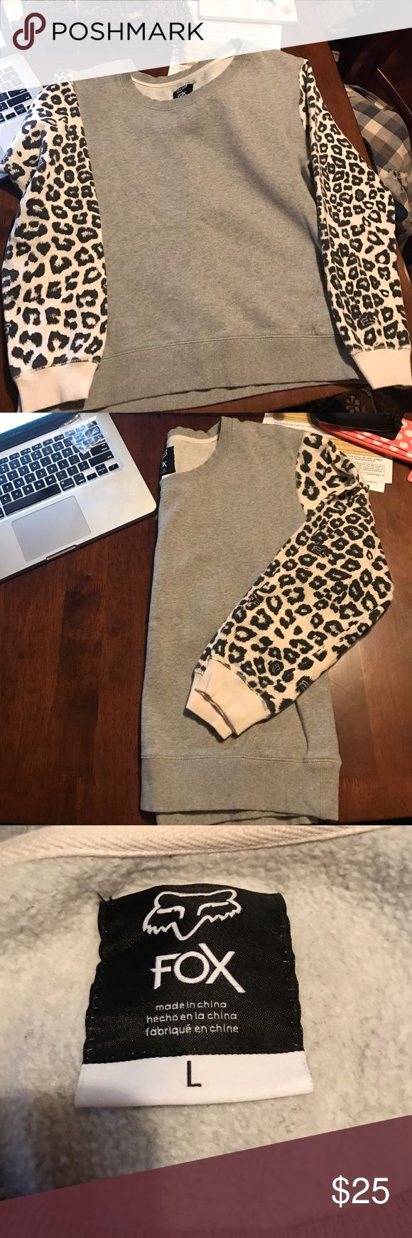 Fox sweat shirt with cheetah print sleeves Fox brand sweatshirt. Cheetah print with fox on sleeves. Hardly worn, size Large. Great condition. Light heather grey, and warm and fuzzy underneath. Fox Tops Sweatshirts & Hoodies