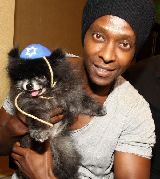 Edi Gathegi with dog