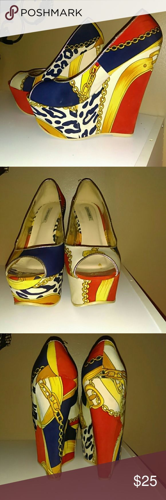 Very cute colorful wedges!! Colorful wedges...Versace inspired..name brand by Lovely People!! Orange blue green yellow!! Great condition the heels of shoe great condition...can be worn with any outfit...?? Lovely People Shoes Wedges