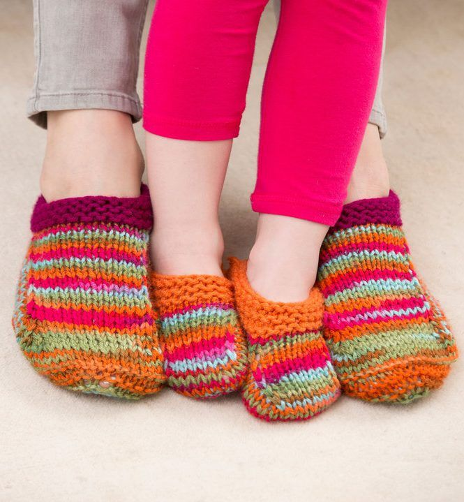 Free knitting pattern for Mom and Me Slippers - These easy cozy slippers look great in multi-color yarn. Three sizes to fit child through adult.