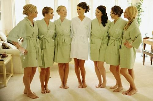 Custom robes for bridesmaids. Paired with custom bridesmaid champagne glasses! Perfect wedding party gift :)
