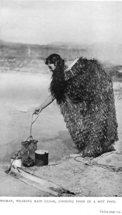woman wearing rain cloak, cooking food in a hot pool,