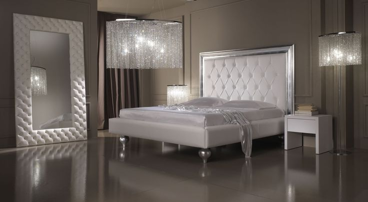 Bed Contrast Capitonnee in leather or fabric and wooden frame in silver leaf  composed with Cooper Night tables.