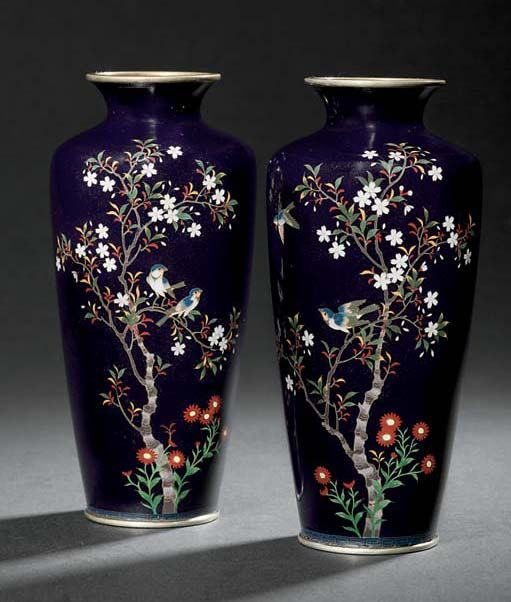 A PAIR OF CLOISONNÉ VASES  MEIJI PERIOD (LATE 19TH CENTURY)  Worked in gold and silver wire and coloured enamels on a dark blue ground with birds in cherry blossom, silvered mounts
