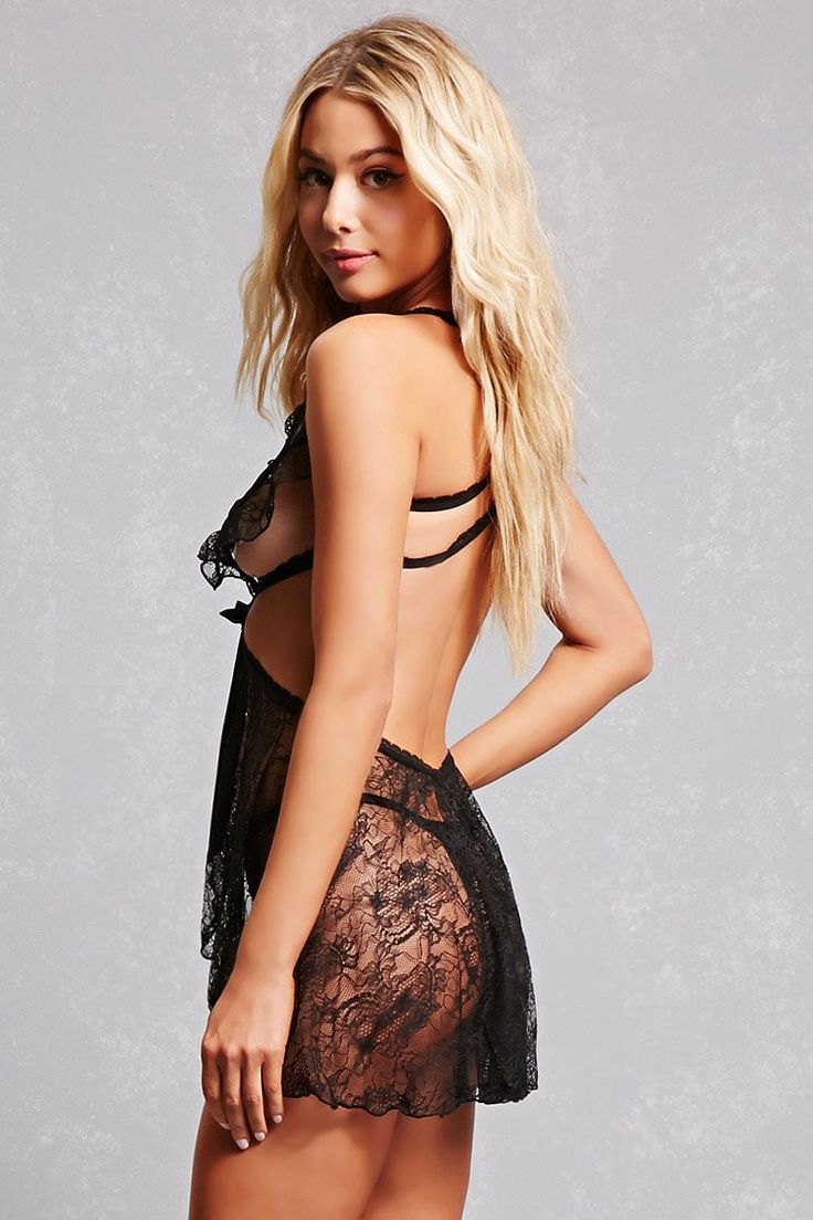 A semi-sheer lace knit lingerie set by Oh La La Cheri™ featuring an adjustable strappy lingerie slip with caged cutouts and a ribbon self-tie, as well as a strappy G-string thong.