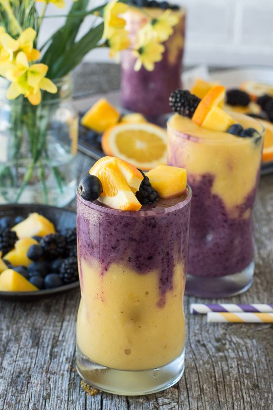 This two layer Hawaiian Berry Smoothie has an orange mango layer and a berry layer! Top the smoothie with a skewer filled with fresh fruit http://papasteves.com/