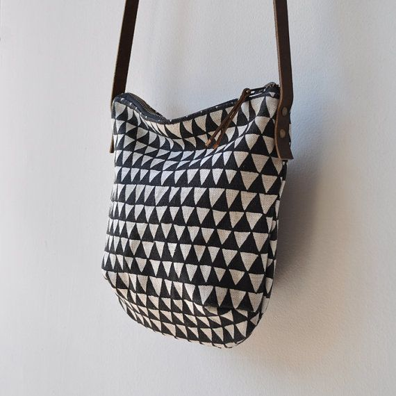 a small bag for you to carry when you dont want to tote around a large bag, our popular triangle image printed with black solvent free ink on both