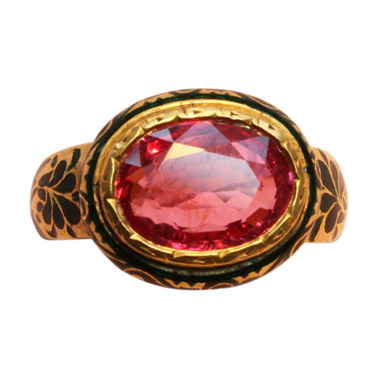 A high carat gold ring set with an oval cut natural pink spinel (app. 4.6 carats), the shank with green enamel floral decorations in the shank, India, circa 1980.