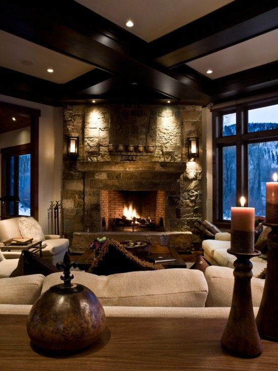 River Bend Ranch Phillips Development. I love the fireplace stone wall, and the warmth in the room!! :)