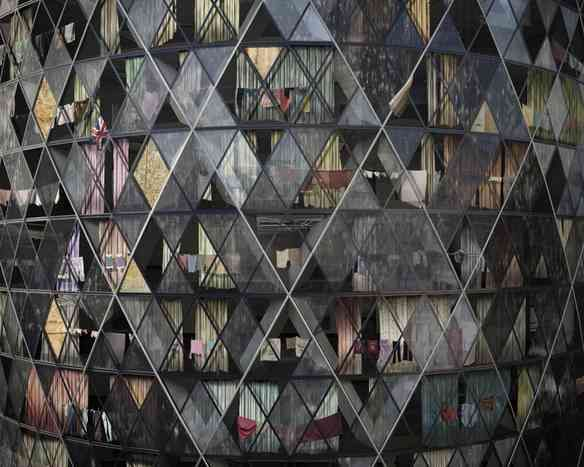 The Gerkin becomes low-market refugee housing after the fall of the world economy.