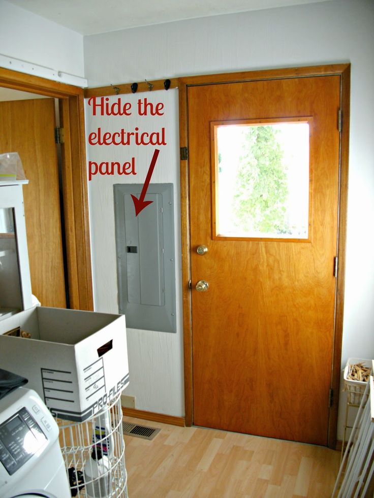 Here is an easy way to hide an ugly electrical panel and hot water heater for very little money!