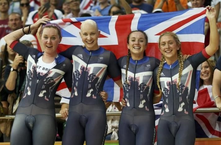The British team of Kate Archibald, Joanna Rowsell, Elinor Barker, and Laura Trott won gold with a new WORLD RECORD in women's team pursuit