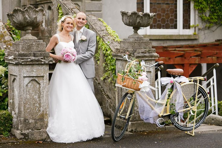 Couple at Finnstown, beside the bicycle