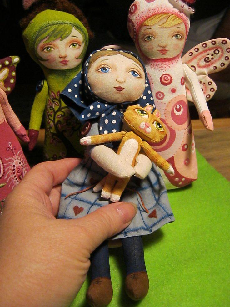 Little Babushka rag doll with kitty.
