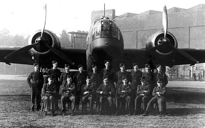 Group portrait in front of a Vickers Wellington Bomber.