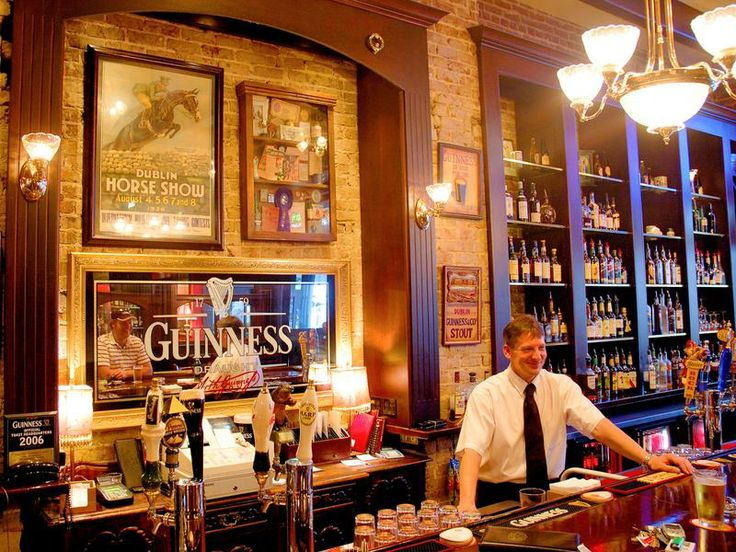 LOVE the Guiness mirror, exposed brick and pictures!! Definitely  inspiration for bar