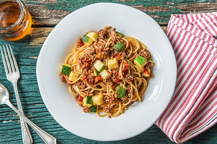 Spaghetti with tomato sauce is always a recipe for success. Is there anyone who'd turn down a plate of noodles piled high and dusted with cheese? Surely not, although adding some extra meat and veg certainly makes it all the more crave-able. Which is exactly what we're doing in this version: taking a tried-and-true Italian American classic and filling it out with hearty ground beef and bites of tender zucchini.