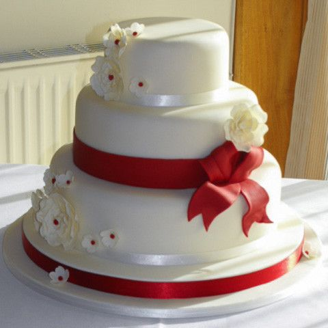 red ribbon wedding cakes wedding cake with fondant ribbon and large open roses 19143
